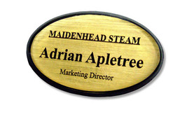 Shaped plastic name badges - Black border and brushed gold background | www.namebadgesinternational.ae